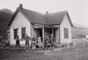 Soliders displaying Wolf pelt at Soda Butte Creek patrol station, Yellowstone National Park, 1905